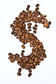 Dollar symbol made with a coffee grain — Stock Photo