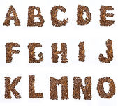 Letters of alphabet made with the coffee in grain — Stock Photo