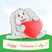 Hare with a heart a congratulation — Stock Vector