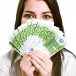Happy young woman holding money — Foto Stock