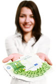 Happy young woman holding money — Stock Photo