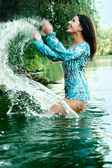 Beautiful girl bathing in a lake — Stock Photo