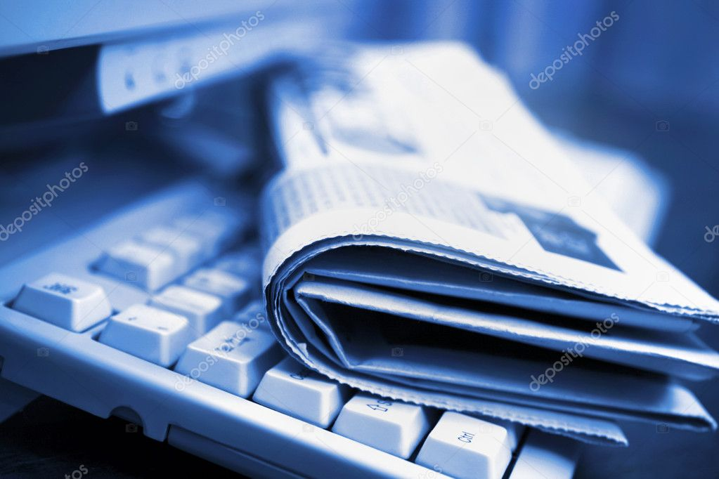 Newspapers on the computer keyboard close up — Stock Photo #5263287