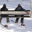 Stock Photo: Snowboarders on ski lift
