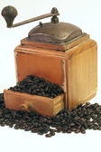 Antique Coffee Grinder with coffee beans — Stock Photo