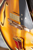Abstract jazz guitar on stand — Stock Photo
