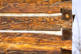 Antique square log cabin wall end — Stock Photo