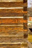 Portrait photo of antique square log construction — Stock Photo