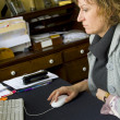 Portrait photo of woman working at a home office on a computer - Stock fotografie