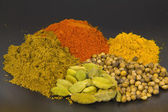 Indian spices isolated on black — Stock Photo
