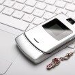 Постер, плакат: Call me Mobile phone on a white laptop