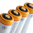 Batteries in row. - Stock Photo