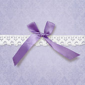 Violet background with bow and lace — Stock Photo