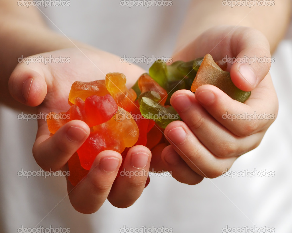 A Boys offers to share his candies to his friends  Stock Photo #4757137