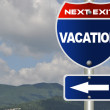Vacation road sign - Stock Photo