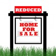 Stock Photo: Real Estate home for sale sign, price reduced