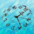 Clock sinking into water — Stock Photo
