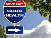 Good health road sign with blue sky — Stock Photo