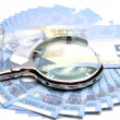 Stock Photo: Close-up money and magnifier background