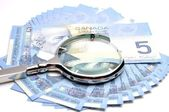 Close-up money and magnifier background — Stock Photo