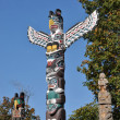 Stock Photo: Indipainted totem poles