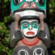Stock Photo: Indipainted totem poles in Canada
