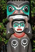 Indian painted totem poles in Canada — Stock Photo