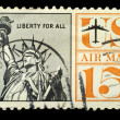 Stock Photo: Old vintage uspostage air mail stamp liberty for All