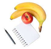 Kladblok met banaan apple en pen — Stockfoto