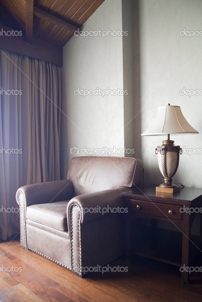 Classic interior with lamp and leather armchair — Stock Photo #5365131