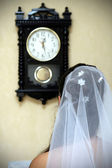 Bride and clock — Stock Photo