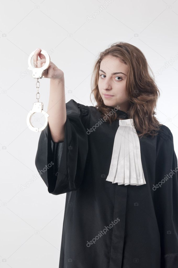 Young law school student holding a pair of handcuffs — Stock Photo #5133259