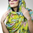 Stock Photo: The beautiful girl in a motley scarf