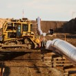 Machinery and pipes laid out for Natural Gas Pipeline — Stock Photo #4852575
