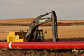Tracked hoe laying pipes for Natural Gas Pipeline — Stock Photo