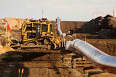 Machinery and pipes laid out for Natural Gas Pipeline — Stock Photo