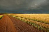 Storm clouds along a Saskatchewan country road — Stock Photo