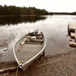 Beached motor boat on Northern Manitoba lake — Stock Photo