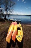 Kayaks at waters edge on Lake Winnipeg — Stock Photo