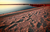Beach and dock along shore of Lake Winnipeg — Stock Photo