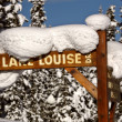 Snow packed on Lake Louise Drive sign — Stock Photo #5034334