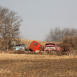 Stock Photo: Discarded farm vehicles in fall