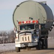 Truck carrying fuel storage tank — Stock Photo