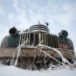 Stock Photo: Frontend of an abandoned olf farm truck in winter