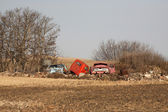 Discarded farm vehicles in fall — 图库照片