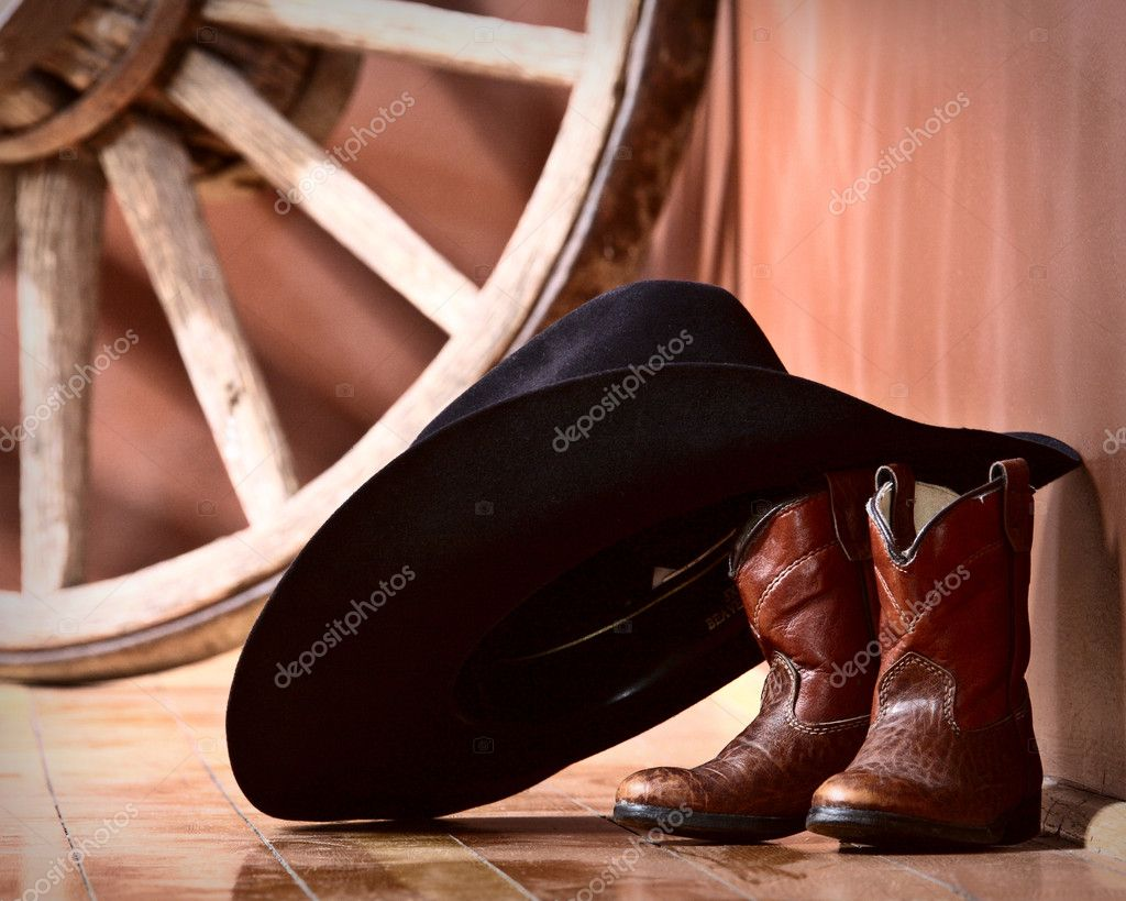 Cowboy hat leaning on small boots  Stock Photo #5170293