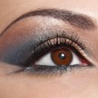 Beautiful shape of female eye with golden-brown cosmetic make-up — Stock Photo