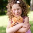 Beautiful girl embraces a teddy bear — Stock Photo