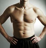 Lichaam van de man van de fitness — Stockfoto