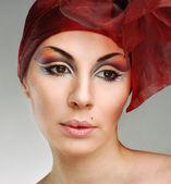 Beautiful woman with art make-up — Stockfoto